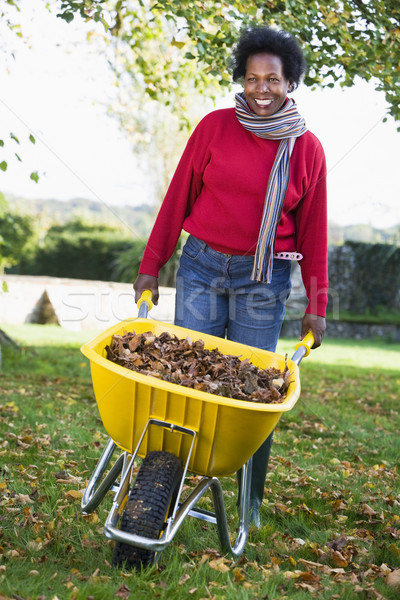 Mature woman collecting leaves in garden Stock photo © monkey_business