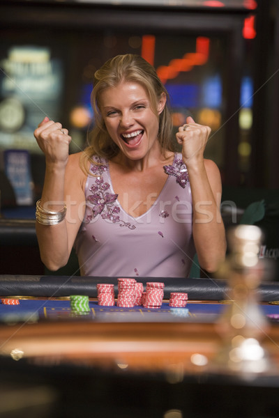 Woman winning  at roulette table Stock photo © monkey_business