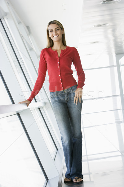 Woman standing in corridor smiling Stock photo © monkey_business