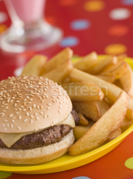 Cheeseburger in a Sesame Seed Bun with Chunky Chips Stock photo © monkey_business