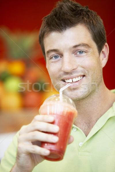 Férfi iszik bogyó smoothie boldog szín Stock fotó © monkey_business