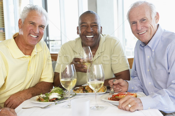 Friends Having Lunch Together At A Restaurant Stock photo © monkey_business