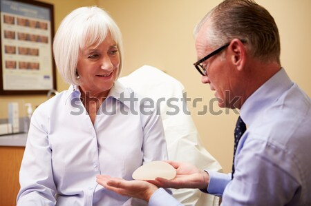 A teacher instructs a schoolgirl in a high school class Stock photo © monkey_business