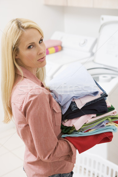 Woman Carrying Folded Up Laundry Stock photo © monkey_business