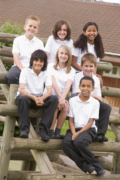 School children sitting on benches outside Stock photo © monkey_business