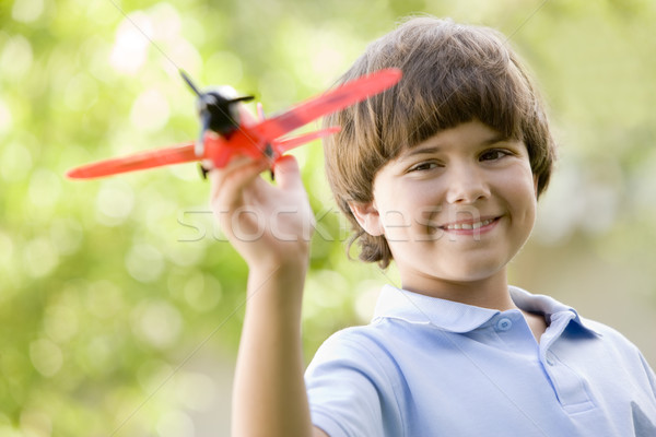 Young boy with toy airplane outdoors smiling Stock photo © monkey_business