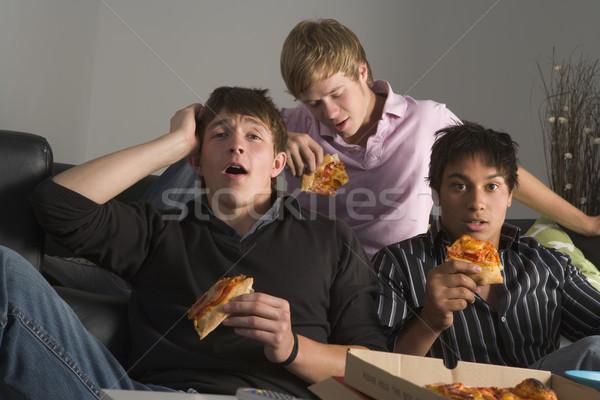 十代の少年たち 食べ ピザ ホーム グループ ラウンジ ストックフォト © monkey_business