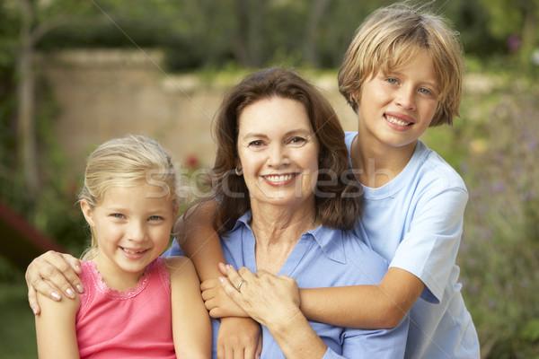 Grand-mère petits enfants jardin heureux enfant garçon Photo stock © monkey_business