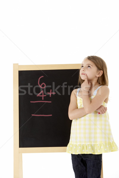 Young Girl Looking Thoughtful Next To Blackboard Stock photo © monkey_business