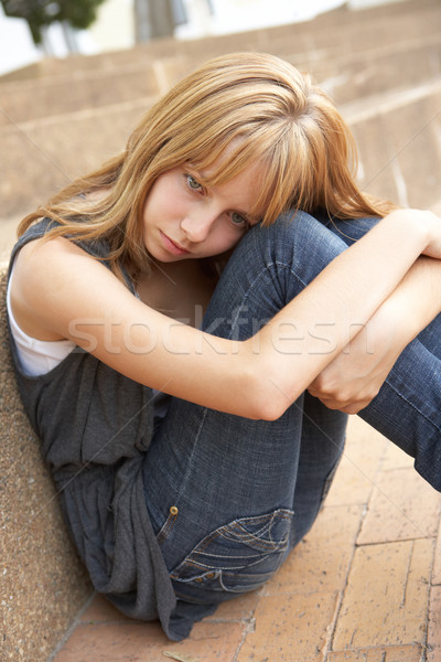 Unhappy Female Teenage Student Sitting Outside On College Steps  Stock photo © monkey_business