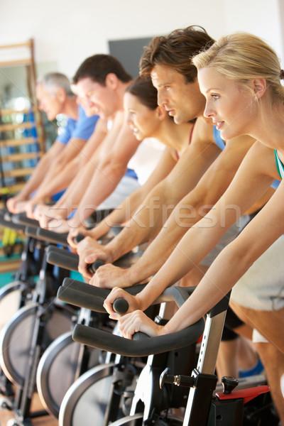 Człowiek rowerowe klasy siłowni mężczyzn uruchomiony Zdjęcia stock © monkey_business