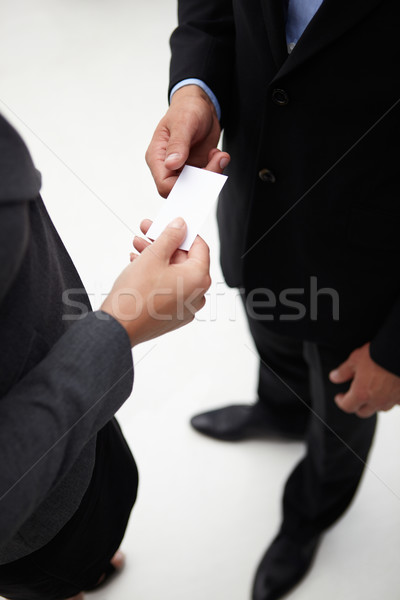 Detail businessman and woman exchanging cards Stock photo © monkey_business