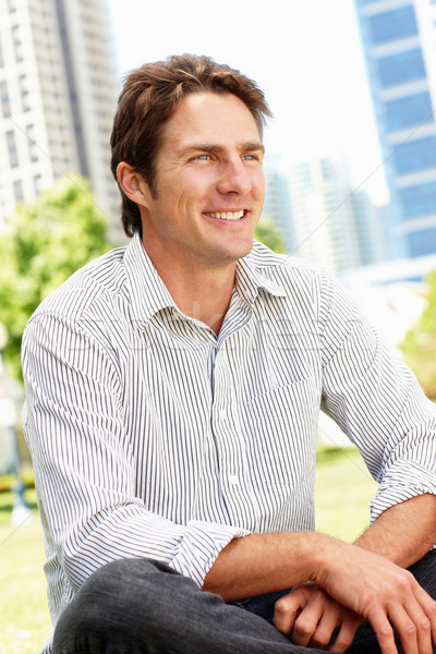 Man sitting in city park Stock photo © monkey_business