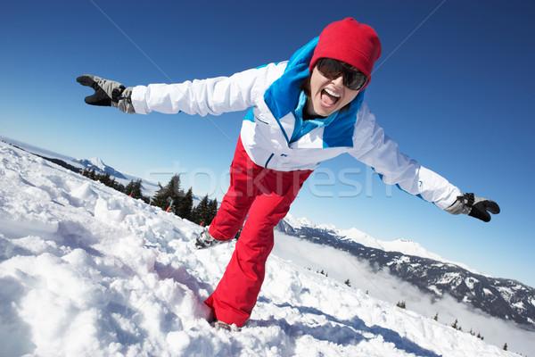 Woman Having Fun On Ski Holiday In Mountains Stock photo © monkey_business