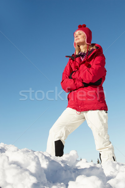 Woman Standing In Snow Wearing Warm Clothes On Ski Holiday In Mo Stock photo © monkey_business