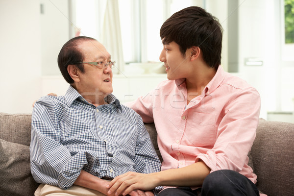 Portrait Of Chinese Father With Adult Son Relaxing At Home Stock photo © monkey_business