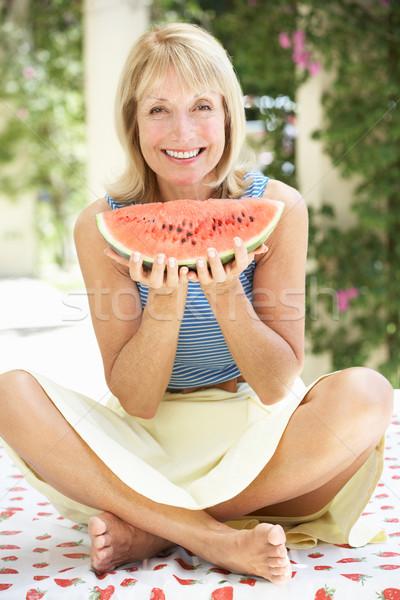 Senior Woman Enjoying Slice Of Water Melon Stock photo © monkey_business