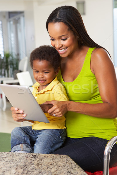 Stock photo: Mother And Son Using Digital Tablet In Kitchen Together