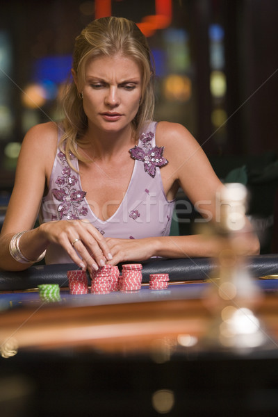 Woman concentrating at roulette table Stock photo © monkey_business