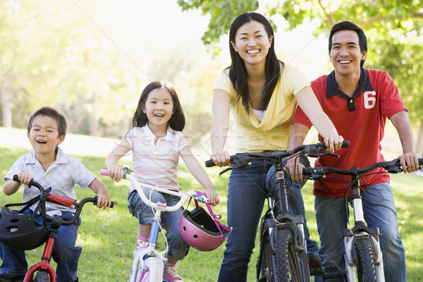 Family on bikes outdoors smiling Stock photo © monkey_business
