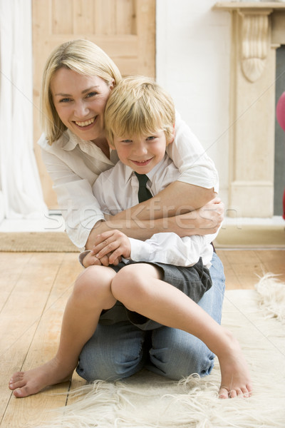 Woman in front hallway hugging young boy and smiling Stock photo © monkey_business