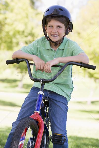 Młody chłopak rower odkryty uśmiechnięty dzieci dziecko Zdjęcia stock © monkey_business