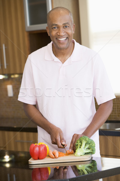 Man Chopping Vegetables Stock photo © monkey_business