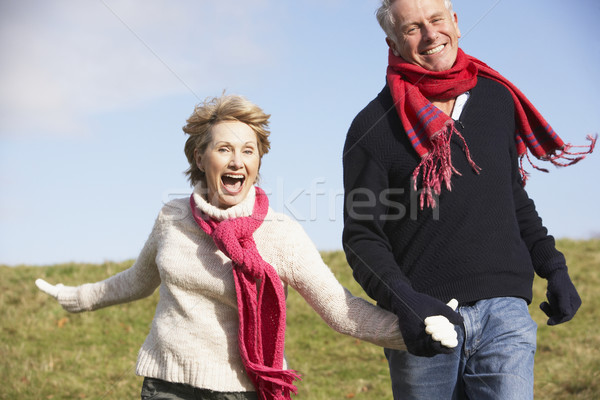 Stock photo: Senior Couple Running In The Park