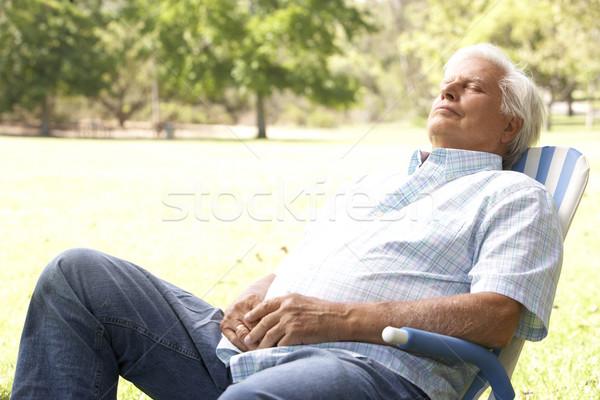 старший человека расслабляющая парка счастливым саду Сток-фото © monkey_business