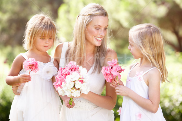 Bride With Bridesmaids Outdoors At Wedding Stock photo © monkey_business