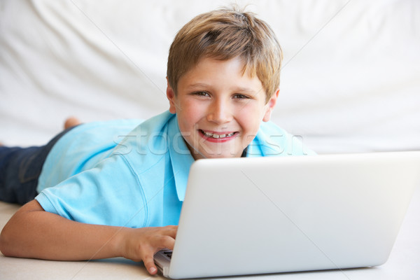 Young boy on his laptop computer Stock photo © monkey_business