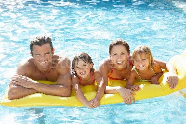 Young family, parents with children, in pool Stock photo © monkey_business
