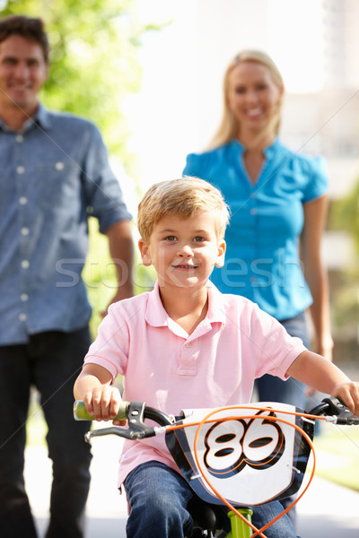 Parents with boy on bike Stock photo © monkey_business