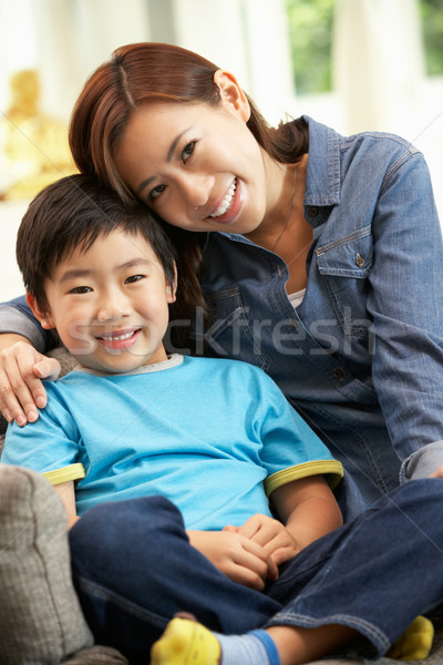 Chinese Mother And Son Sitting On Sofa At Home Together Stock photo © monkey_business
