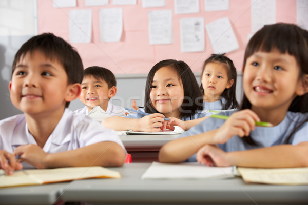 Group Of Students Working At Desks In Chinese School Classroom Stock photo © monkey_business