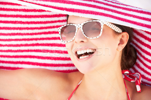 Woman Sheltering From Sun On Beach Holiday Stock photo © monkey_business