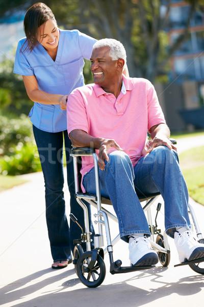 Bakıcı itme kıdemli adam tekerlekli sandalye kadın Stok fotoğraf © monkey_business