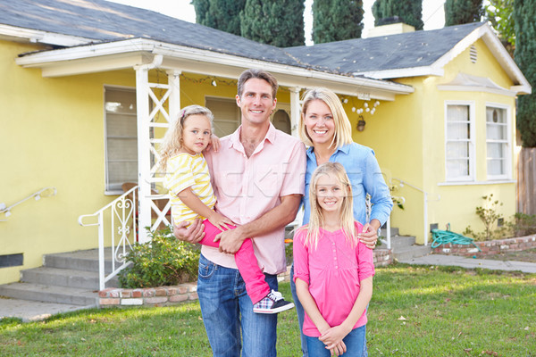 Family Standing Outside Suburban Home Stock photo © monkey_business