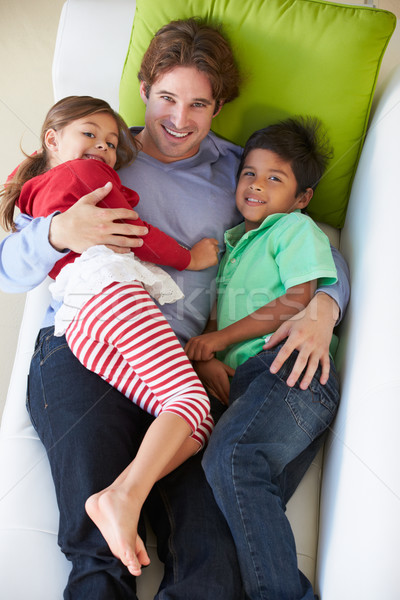 Stockfoto: Vader · kinderen · ontspannen · sofa · liefde