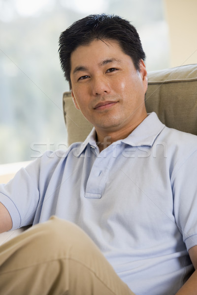Man sitting in living room Stock photo © monkey_business