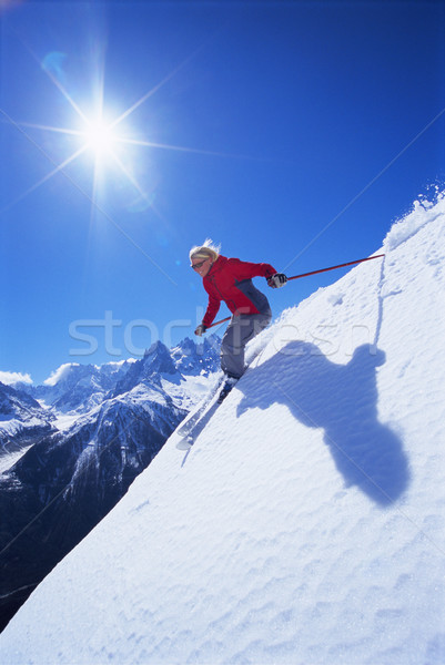 Stock photo: Young woman skiing
