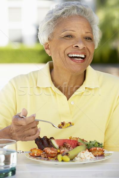 Stockfoto: Senior · vrouw · dining · tuin · tabel