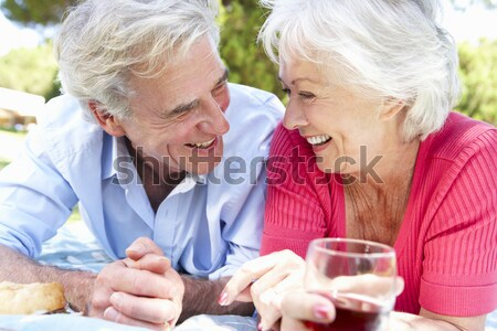 Couple in living room drinking champagne and smiling Stock photo © monkey_business
