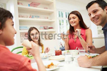 Three young women in their underwear having a tea party Stock photo © monkey_business