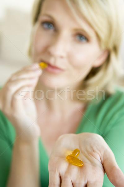 Woman Taking Pills Stock photo © monkey_business
