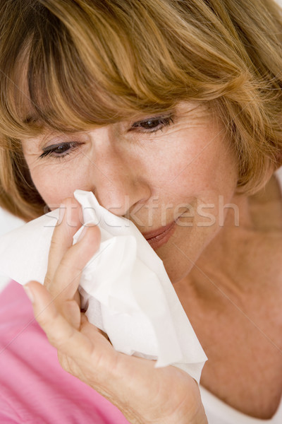 Woman Blowing Her Nose Stock photo © monkey_business