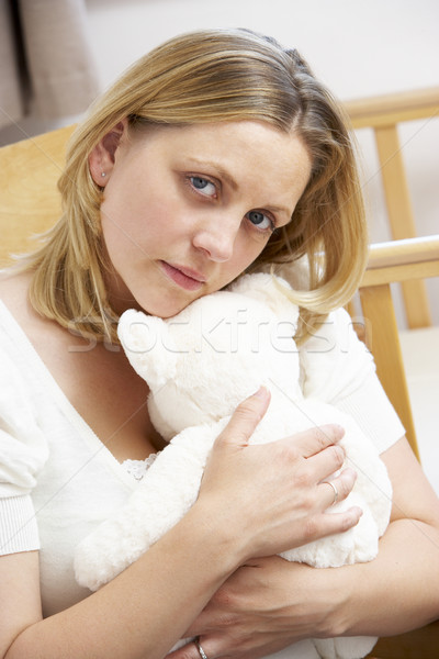 Sad Mother Sitting In Empty Nursery Stock photo © monkey_business