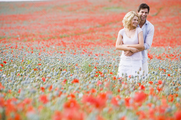 Couple in poppy field embracing and smiling Stock photo © monkey_business