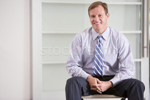 Businessman sitting indoors smiling Stock photo © monkey_business