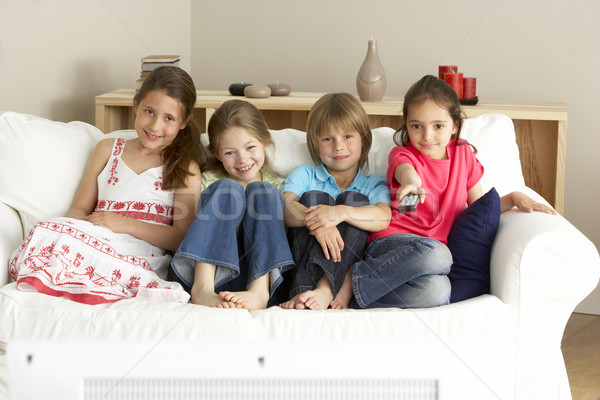 Stock photo: Young Children Watching Television at Home